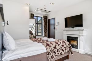 A bed or beds in a room at Frogner House Apartments - Nygata 24