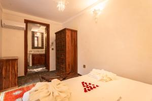 A bed or beds in a room at Aix Kabaj Palais & Spa