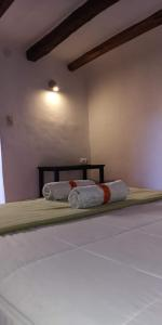 Cama o camas de una habitación en Inka Hallpa