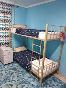 A bunk bed or bunk beds in a room at Каменка