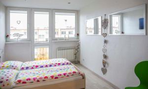 Łóżko lub łóżka w pokoju w obiekcie Apartament Gościnny Magda