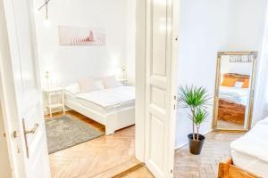 Letto o letti in una camera di Janas Apartments