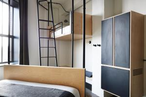 A bed or beds in a room at The Robey