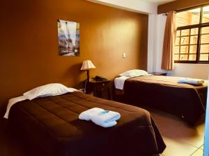 A bed or beds in a room at Huaraz Hotel & Lodging