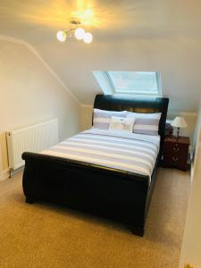 A bed or beds in a room at London Home