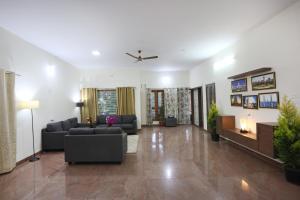 The lobby or reception area at LikeMyHome Homestay Mysore