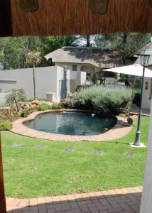 The swimming pool at or near Buller's Rest Guest Lodge