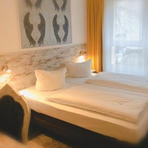 Ein Bett oder Betten in einem Zimmer der Unterkunft Hotel Kiez Pension Berlin