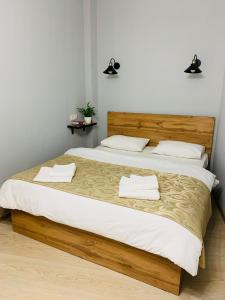 A bed or beds in a room at Hotel Kazantel