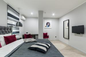 A bed or beds in a room at Design-hotel Tchaikovsky