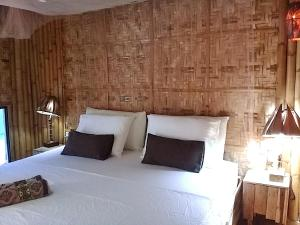 Ein Bett oder Betten in einem Zimmer der Unterkunft Herbs Guest House - Adults Only