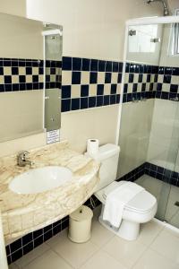 A bathroom at Hotel Das Pedras