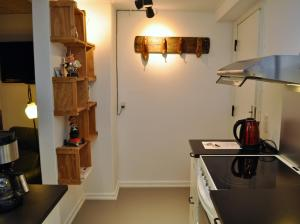 A kitchen or kitchenette at Krudthuset Byferie Odense City