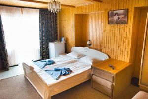 Кровать или кровати в номере ТерКон-Тур