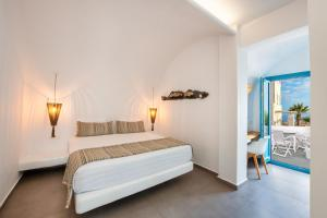 A bed or beds in a room at Evgenia Villas & Suites by Calm Collection