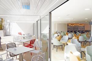 Een restaurant of ander eetgelegenheid bij Hotel Troya