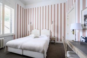 A bed or beds in a room at Hotel Made In Louise