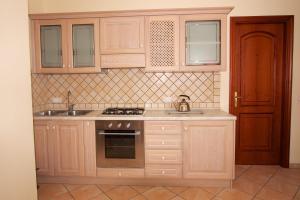 A kitchen or kitchenette at Sine Tempore