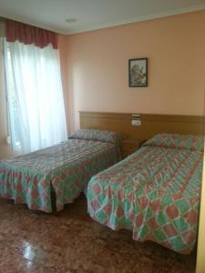 A bed or beds in a room at Hotel Durtzi