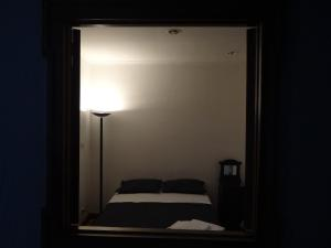 A bed or beds in a room at Lucia - Central