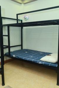 A bunk bed or bunk beds in a room at Thức at 3am