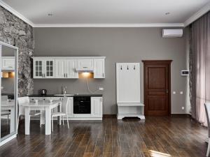 Кухня или мини-кухня в Отель Абаата