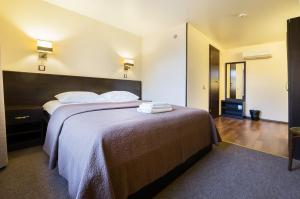 Кровать или кровати в номере Гостевой дом у Садовой