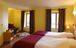Un ou plusieurs lits dans un hébergement de l'établissement Auberge du Couvige