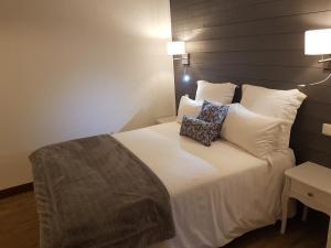 Un ou plusieurs lits dans un hébergement de l'établissement L'Echo des Montagnes