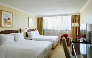 A bed or beds in a room at Glasgow Marriott Hotel