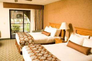 A bed or beds in a room at Borrego Springs Resort and Spa