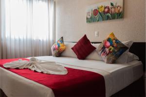 Cama ou camas em um quarto em Hotel Itajara