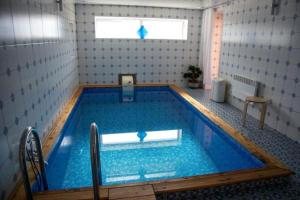The swimming pool at or near Guest House Le Chalet