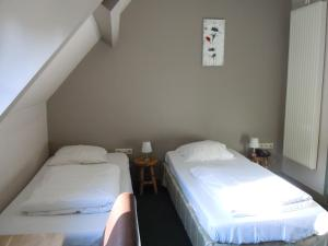 A bed or beds in a room at Hotel Malcot