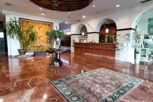 The lobby or reception area at Hotel Spa Milagros Golf