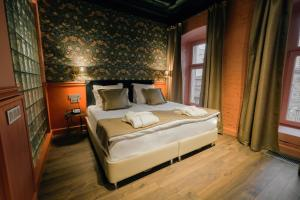 A bed or beds in a room at Boutique Hotel Arbat 6