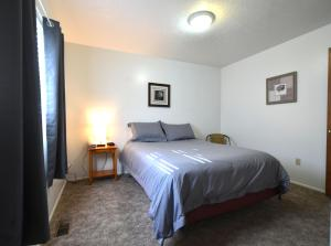 A bed or beds in a room at Top of the Town Vacation Home Rental