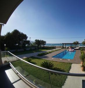 A view of the pool at Niovi Seaside Suites or nearby