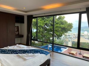 The swimming pool at or near Sunset Bay View Phuket