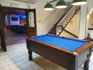 A pool table at Gilson Hotel