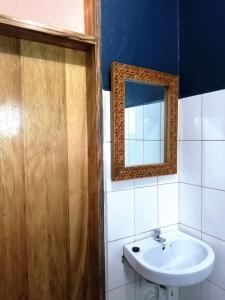 Ein Badezimmer in der Unterkunft Casa Mia Baliidha