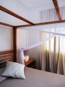 Ein Bett oder Betten in einem Zimmer der Unterkunft Casa Mia Baliidha