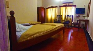 A bed or beds in a room at The Caravela Homestay