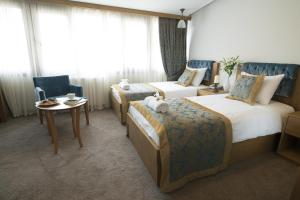 A bed or beds in a room at Cumbali Luxury Boutique Hotel