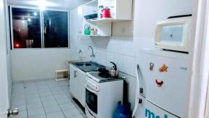 A kitchen or kitchenette at Los Parques de San Gabriel