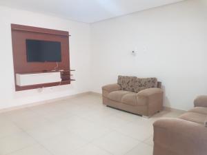 A seating area at Casa de temporada