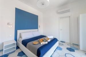 Letto o letti in una camera di Caruso suite
