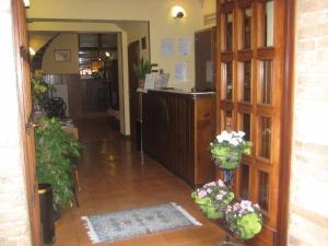 Лобби или стойка регистрации в Hotel San Rufino