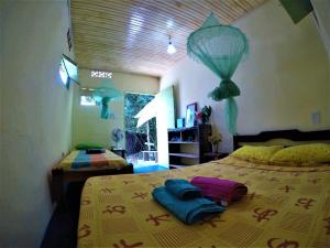 A bed or beds in a room at Hostel Moreré