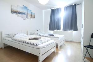 Кровать или кровати в номере Apartmondo Ferienwohnungen